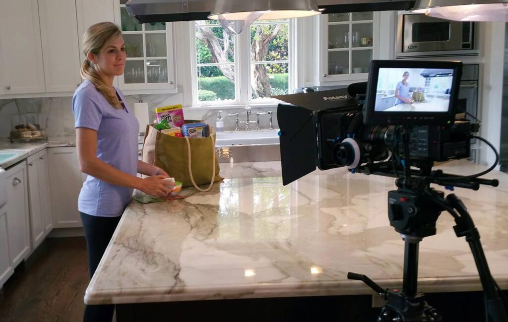 Woman being filmed in kitchen for commercial by Awecast